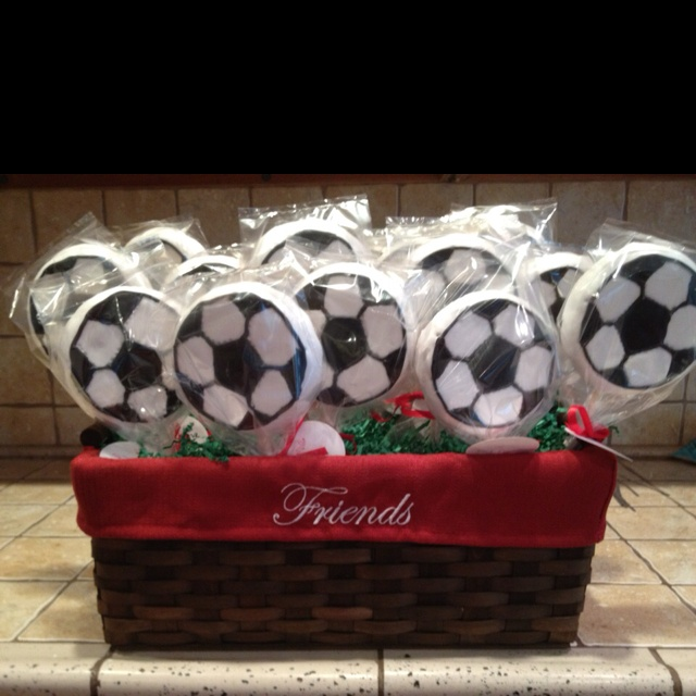 Soccer ball cookie team bouquet. This would be awesome for my Daughter's soccer team.
