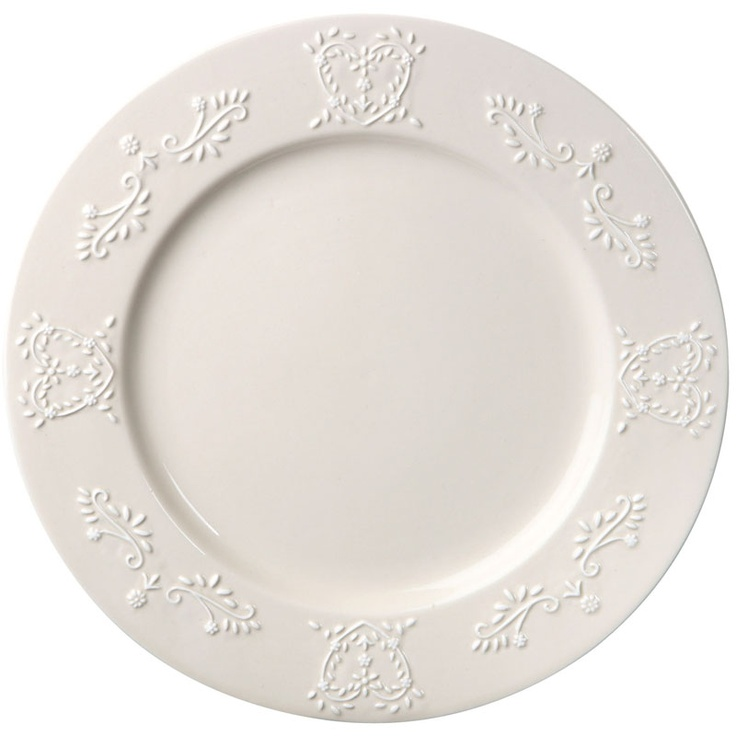 Ivory ceramic dinner plates featuring embossed heart detail