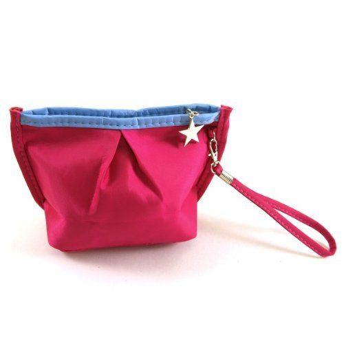 "Vibrant Cosmetic Bag / Mini Clutch - Magenta by Wrapables. $11.95. These Vibrant Cosmetic Bags are colorful and fun! use them to hold your makeup or have them double as a mini clutch! The bag comes with a wrist strap and a star trinket zipper. Dimensions: 3""L x 5""W x 5""H. Material: Nylon, PVC."