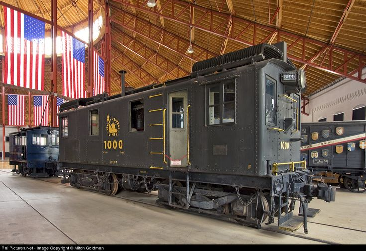 The CNJ 1000 - so much more then meets the eye: A photo that deserves a thousand words and more, this box cab was of American Locomotive / General Electric / Ingersoll Rand construction and was built in Phillipsburg, NJ in 1925. It is the first commercially successful diesel electric locomotive made and sold in the US. The CNJ needed this engine which it used at it's Bronx terminal due to a new law in NYC banning the use of steam within city limits. It had 300 hp. It's small size and…