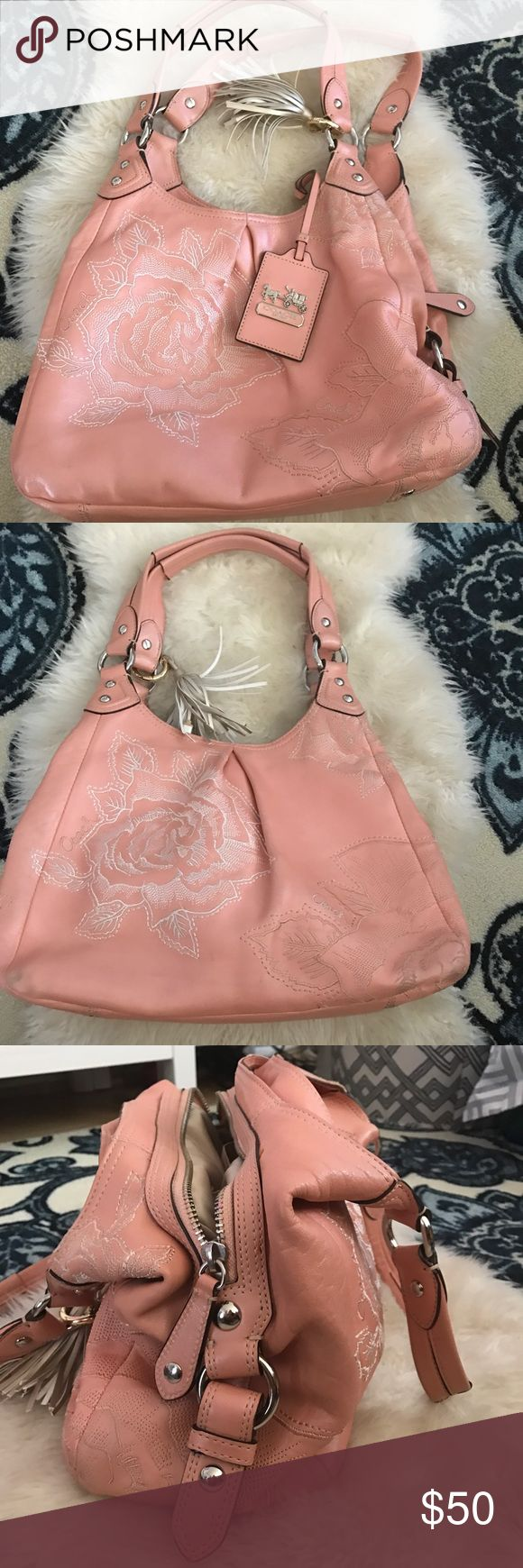 COACH - Hobo Style Purse with Rose Details 🌹 Super cute and perfect for spring Hobo COACH purse. It's a workhorse of a bag with 3 compartments and lots of space in each one.  The color is reminiscent of LV's Rose Ballerine and the rose details are stiched on each side.  Some scuffing on the sides shown in pics (dark corners) *tassel not included* Coach Bags Hobos