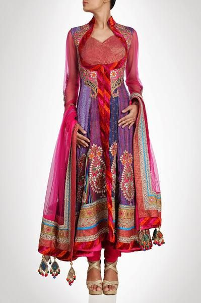 This high neck long anarkali suit is in purple color silk. Each kali of this anarkali suit is of different designer silk fabric. This suit is on Sale
