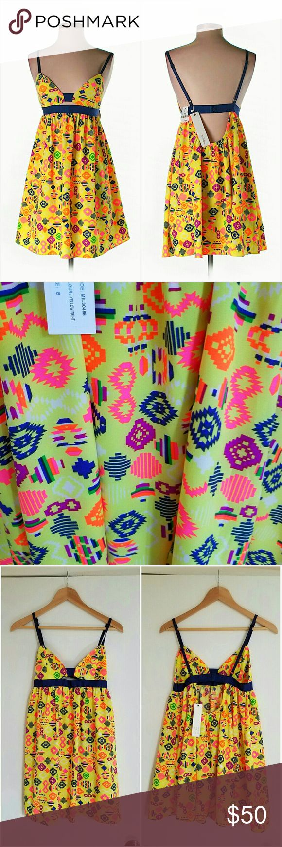 """NWT LF Neon Yellow Aztec Cutout Sun Dress Brand new w/ tags. Neon yellow Aztec print dress w/ green, navy, yellow, & neon pink & orange accents. Triangle cups & cutout front. Adjustable straps. Navy elastic band waist w/ bra-like adjustable hook & eye closure. Scoop back. 100% Polyester. Retailed for $178 at LF. By Millau. Sz S.   Length= 30"""" shoulder to hem but can go up/down depending on strap length. Last pic modeled same dress, diff print.  Please check out my closet for more NWT LF…"""