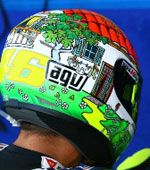Valentino Rossi 'My House' helmet (Misano 2008): The custom designed helmet that Rossi wore at the Misano round of MotoGP in 2008 was designed to celebrate his home race and featured a cartoon house surrounded by common Rossi images, including his late Bulldog Guido. More: http://rossihelmets.com/rossis-helmets/2008-motogp-rossi-helmets/agv-gp-tech-misano-2008/