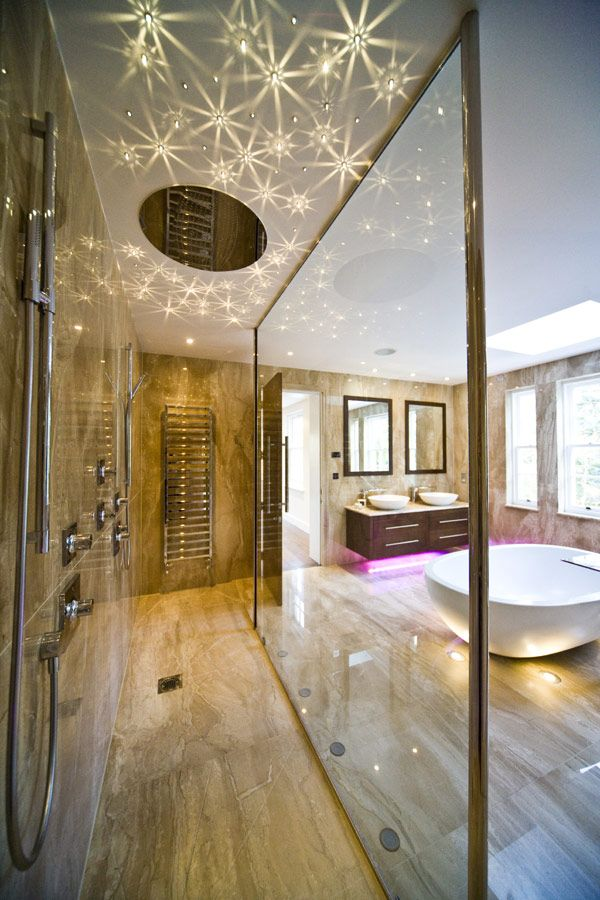 Another sexy and fabulous bathroom. Sparkling Swarovski downlights in the shower room add a magical touch to an already amazing space. Designed by Blanca Sanchez of Halo design Interiors. Home is located in the UK.