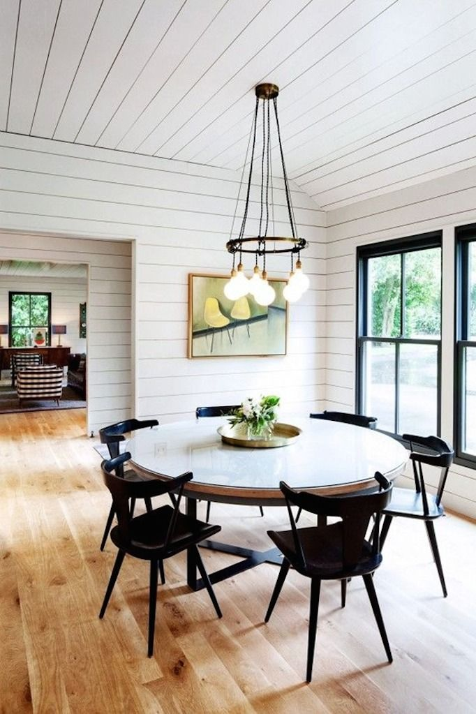 Dining Space Trend - Black Accents - Shiplap walls and black diining chairs for a modern farmhouse dining room