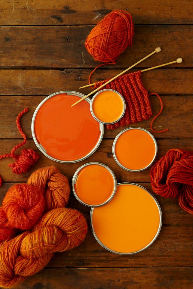 orange wall paint and knitting yarn