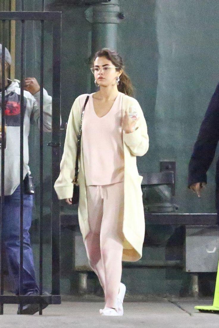 Selena Gomez wearing Puma Basket Sneakers, Jennifer Fisher Baby Samira Hoop Earrings, Skin Veronica Sweater, Skin Vanya Pants and Jason Stalvey 2.0 Alligator Bag in Cognac