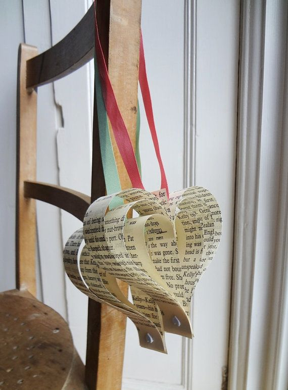 hearts; would look nice hung up on chairs here and there. Not too girlie and the homemade from book pages gives a nice earthy feel --- this is how I want to decorate my chairs rather than ribbons or sashes.