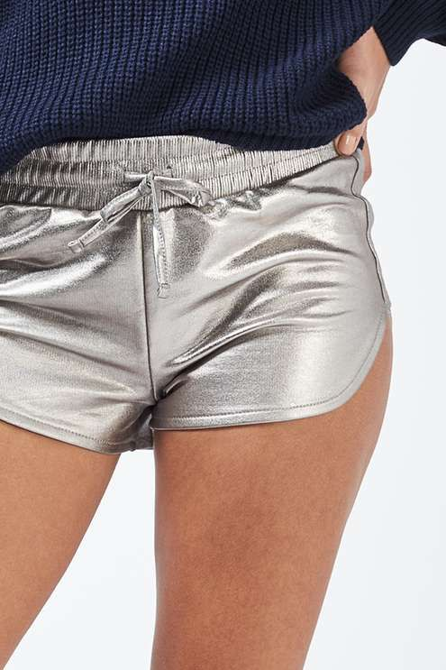 Give your sportswear a metallic makeover with these eye-catching silver foiled runner shorts. In a super-mini cut, wear them dressed down with a hoodie or dress up with a blouse and ankle boots. #Topshop