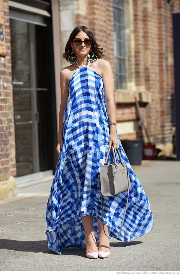Suzanne Knezovic in a flowing plaid patterned maxi dress.