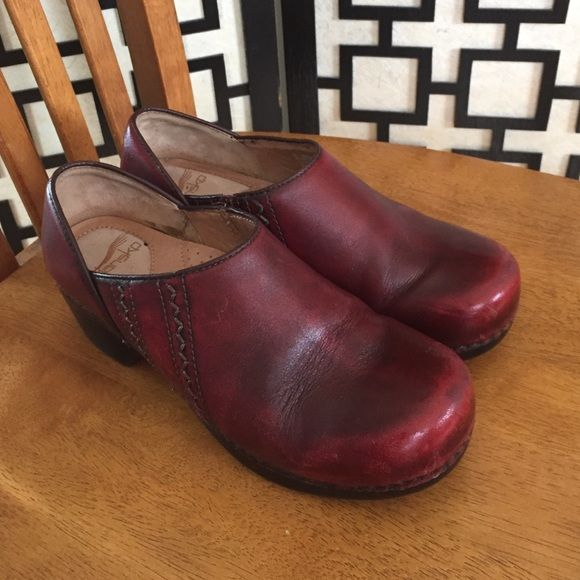 Dansko burgundy shoes These are in overall really good condition but the toes are scuffed and there are a couple of marks on the back of the heels. Bottoms are in excellent condition. I used an express shine shoe polish sponge on these so the marks don't look as bad. Dansko Shoes Mules & Clogs