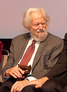 """Alexander """"Sasha"""" Theodore Shulgin is an American pharmacologist, chemist, artist, author and drug developer.  Shulgin is credited with the popularization of MDMA (""""ecstasy"""") and its introduction to psychologists in the late 1970s for psychopharmaceutical use. In subsequent years, Shulgin discovered, synthesized, and bioassayed over 230 psychoactive compounds."""