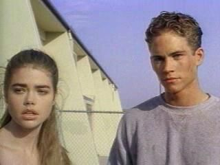 "Denise Richards and Paul Walker from the movie, ""Tammy and the T-Rex."""