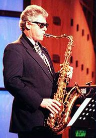 Bill Clinton plays the saxophone
