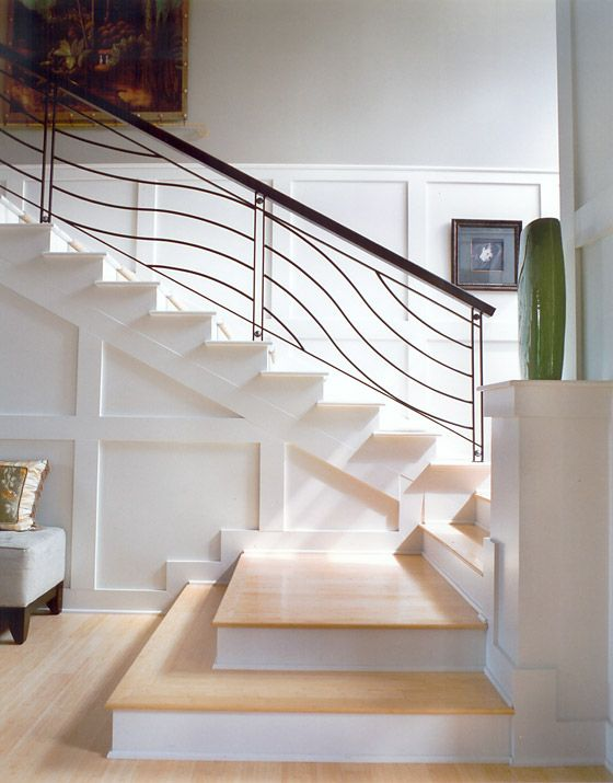 Shingle Style Home With An Interesting Staircase Configuration.