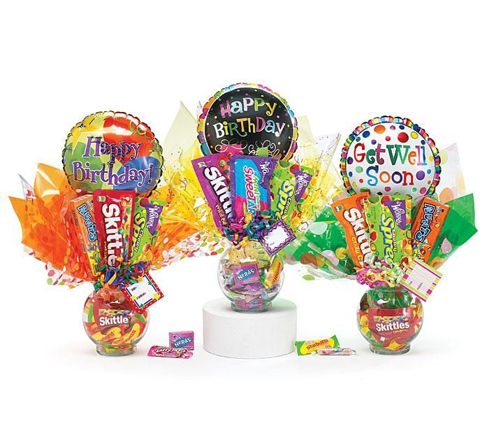 Cute candy bouquets with tissue paper and balloons. Can also be used as party centerpieces
