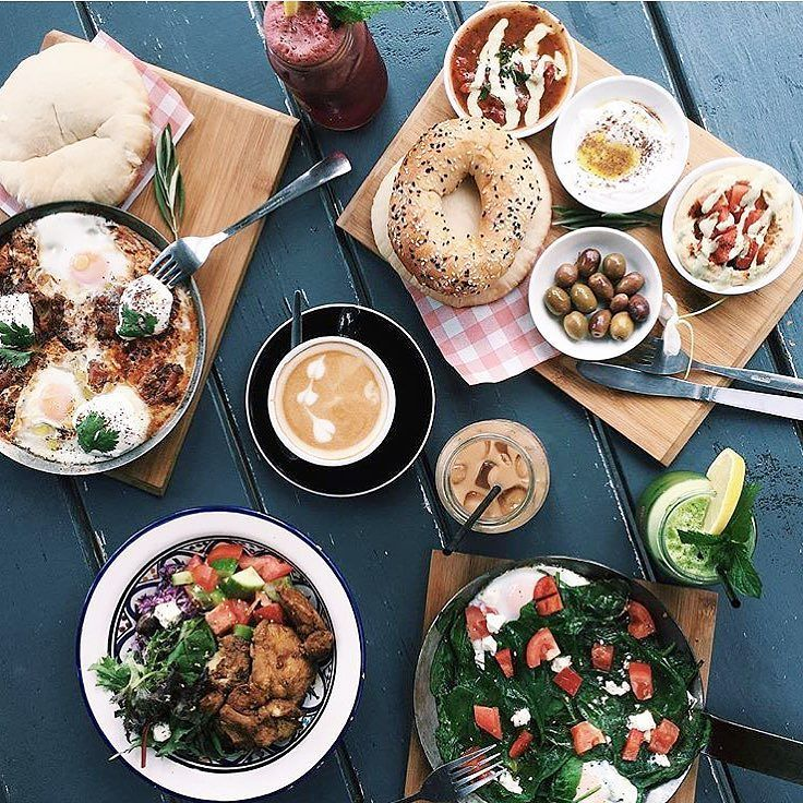 Thanks to @jessie_khoo for delicious brunch pic from last visit at Grandma's  #GrandmasAU #brunch #shakshuka #grandmascoffee #salad #housebread #freshjuices #olives #bagel #rosebery by grandmasau
