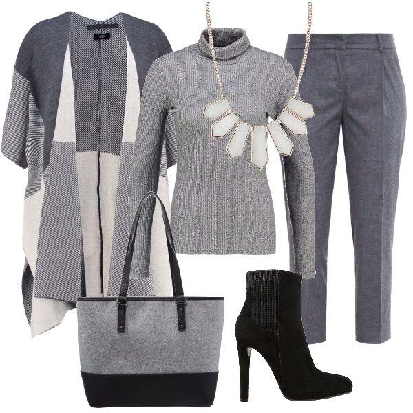 Outfit nei toni del grigio con capi invernali. Pantaloni 7/8 fantasia melange colore grigio, mantella con mezze manica, maglia attillata con collo alto, completano il look: collana con forme geometriche, borsa in lana e stivaletto in pelle nera.