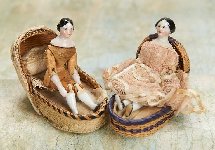 Two Tiny German Porcelain Dolls with Wooden Articulated Bodies…