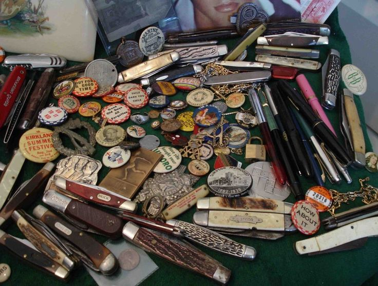 Junk drawer contents. This Junk Drawer...filled with pocket knives, belt buckles, pins w catchy slogans...sold for $234.99