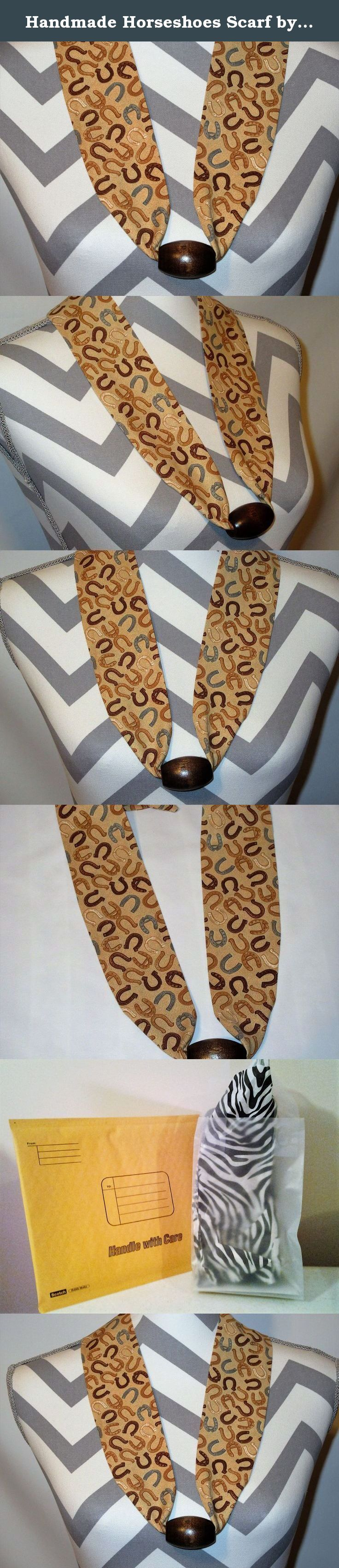 Handmade Horseshoes Scarf by Ladies Fashion Collars Unique No Tie Design with Wood Brown Bead One Size Fits All Lucky Horseshoes on Beige Background Hand Crafted USA. Handmade Ladies Fashion Collars Fabric Scarf Necklace Lucky Horseshoes in Brown tones on a Beige Cotton Fabric with Brown Wood Bead. One Size Fits All; Simply Slip it Over Your Head; Lightweight Only 1 Ounce, Bead holds decorative fabric scarf in place, complementing any neckline. No Tie; No Fuss; No Clasp; Fun and Easy to...