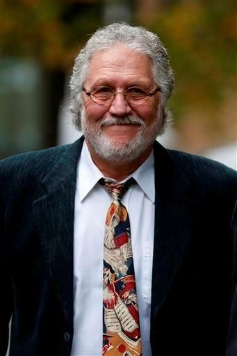 (AP Photo/Sang Tan). British disc jockey Dave Lee Travis arrives for his hearing at Southwark Crown Court in London, Tuesday, Oct. 22, 2013....