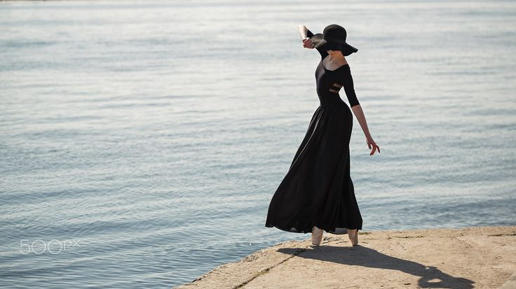 Ballerina in hat and long black dress dance. by Elena Vagengeim on 500px