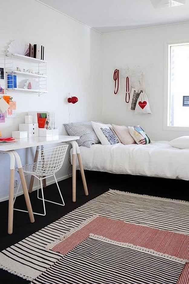 Sobrepor tapetes também é uma ótima opção e pode até ser mais em conta do que comprar uma peça única.