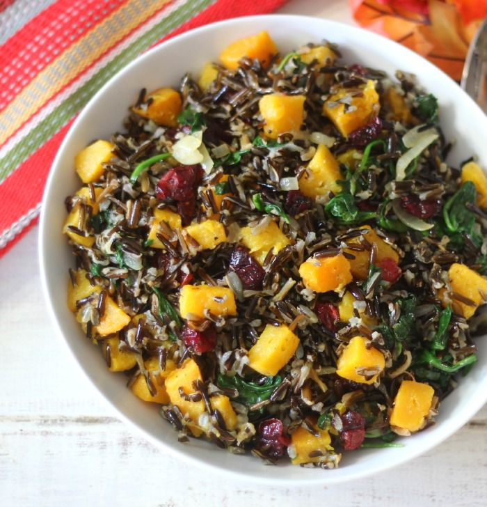Butternut Squash Wild Rice - Roasted sweet butternut squash, sauteed onions, spinach and dried cranberries mixed together with wild rice. #Holidaytable