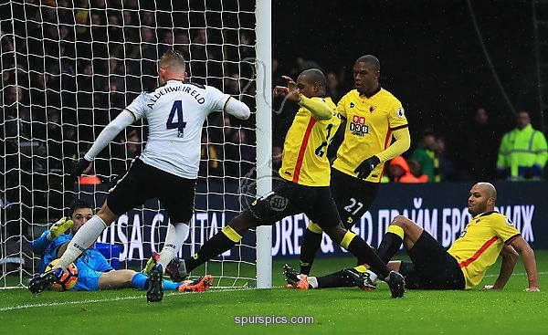 WATFORD, ENGLAND - JANUARY 01: Younes Kaboul of Watford (grounded right) scores their first goal during the Premier League match between Watford and Tottenham Hotspur at Vicarage Road on January 1, 2017 in Watford, England