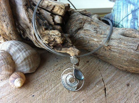 Spiral form pendant with abalone shell on silver spang necklace