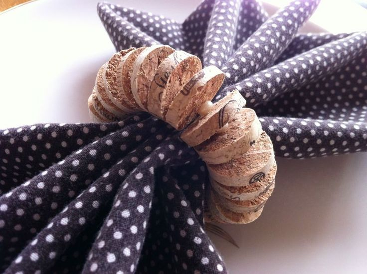 15 Ways to Repurpose Wine Corks -- I say, mix it up with cool beads & shells to make really cool napkin rings!