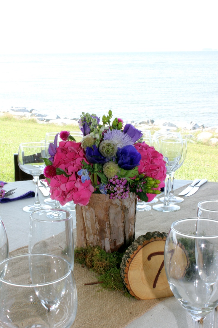 #rustic #casual centerpiece in birchwood pots with pink, blue and purple flowers