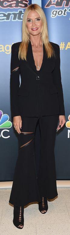 Heidi Klum: Jacket and pants – Versace  Shoes – Sergio Rossi  Bra – Heidi Klum Intimates