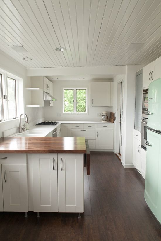 The loveliest kitchen remodel | Mirror Mirror. First time I've ever seen a counter top that I like that ISN'T butcher block or tile.