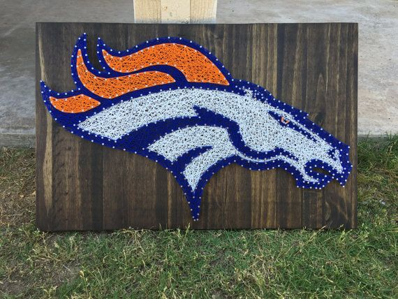Are you a fan of the Denver Broncos? Then this gorgeous string art sign is perfect for you! Or makes a perfect gift for someone who is!  This listing is made to order- measures at approximately 15x24 and the example shown is stained with an espresso stain. Stain options are shown in the last picture, just be sure to include the color or stain you would like in the note to seller. We use high quality pine wood for all of our boards, and due to the beautiful grains in the wood the stains may…