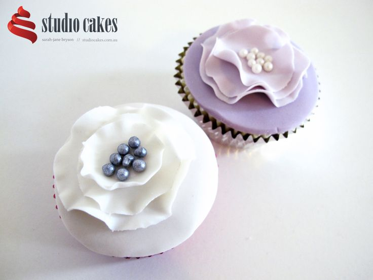 In pretty shades of cream, pink and mauve, these designer vintage cupcakes with quilted cachous, edible pearls and fondant ruffle detailing are perfect for so many different occasions, including Mother's Day, birthdays for girls, engagements, baby showers and more.