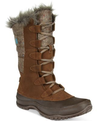 "Battle the elements in style with the Nuptse Purna boots from The North Face. | Imported | Waterproof velvet suede upper | Round closed-toe boots | Lined with polyester faux-fur | Shaft: 10"" height, 1"