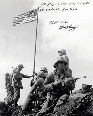 The first Flag Raising at Iwo Jima, Feb. 23, 1945