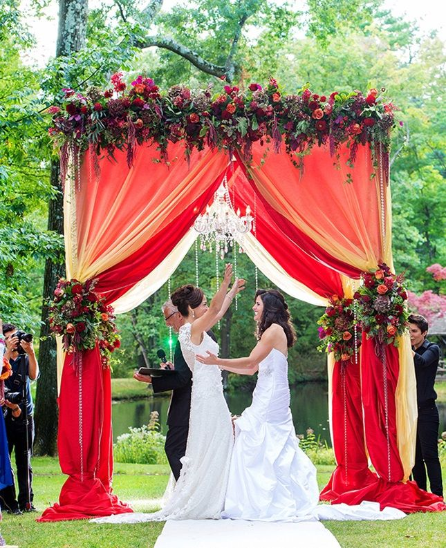 Use fabric to create an elegant floral canopy.