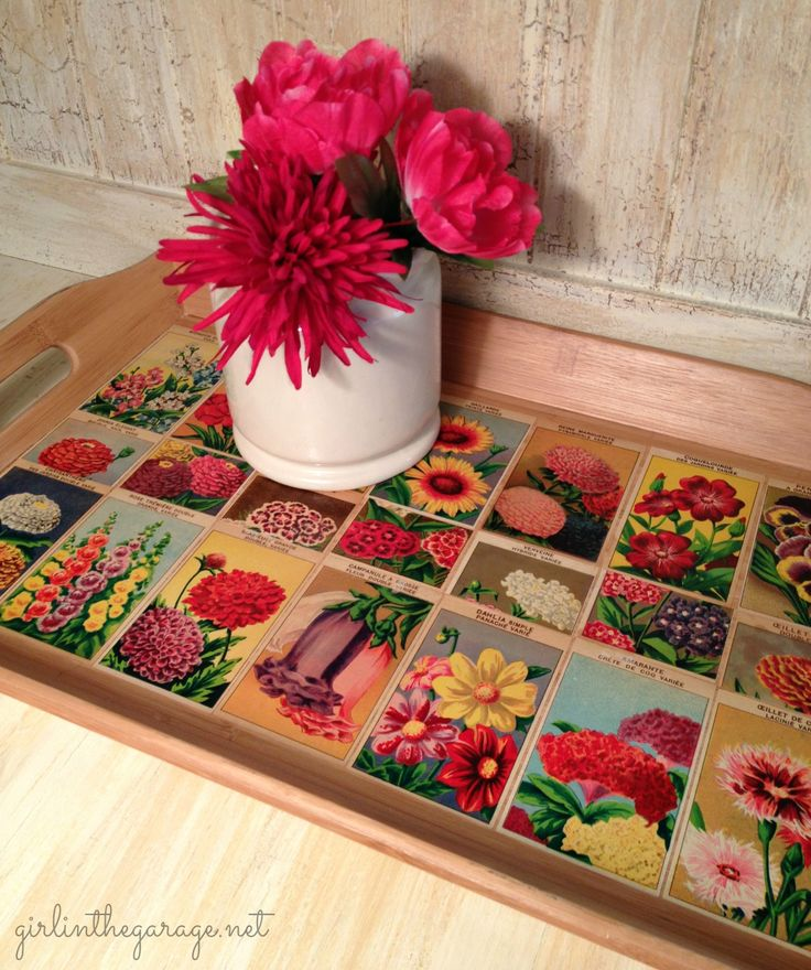 Vintage French flower seed labels decoupaged onto bamboo serving tray.  What a lovely way to welcome spring!  By Girl in the Garage.