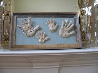 Sand handprints: They look almost a little bit freaky, but I like the idea w/sand and shells...