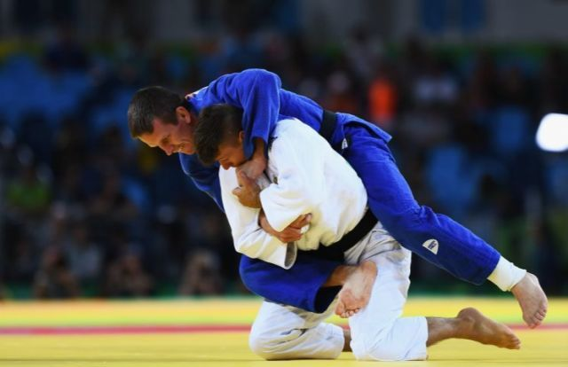 Dirk van Tichelt won his first Olympic judo medal Monday. (Getty)