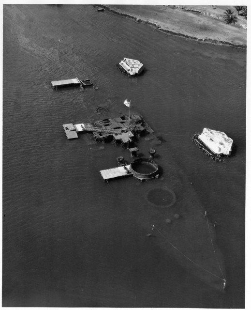 Aerial view of the hull of the battleship Arizona (BB 39) taken during the 1950s prior to the construction of the USS Arizona Memorial.
