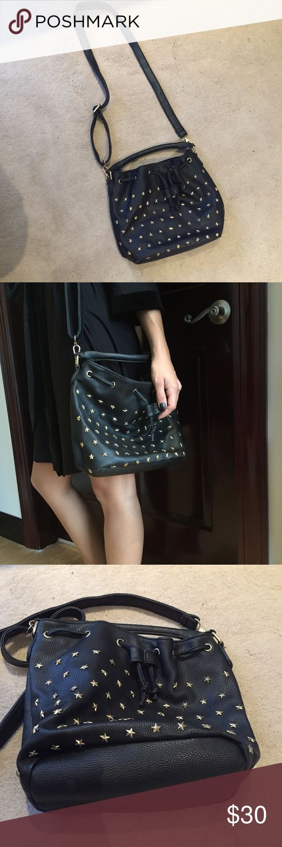 Black star studded purse Black star studded purse from LF. Gold stars. Zipper pouch inside. Perfect condition. Strap is adjustable and can also clip off. LF Bags