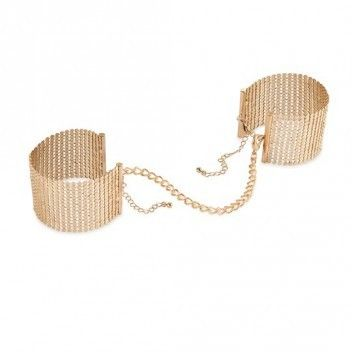 Desir Metallique - Gold Metallic Mesh Handcuffs Reference:  BIJ0143 Condition:  New product  Satisfy your desire to conquer a heart of gold...  An easy-to-wear bracelets for any occasion; privately, they become suggestive handcuffs for soft bondage games.  Its cold and metallic touch turns everything into pleasure!  Content:  metallic mesh handcuffs.