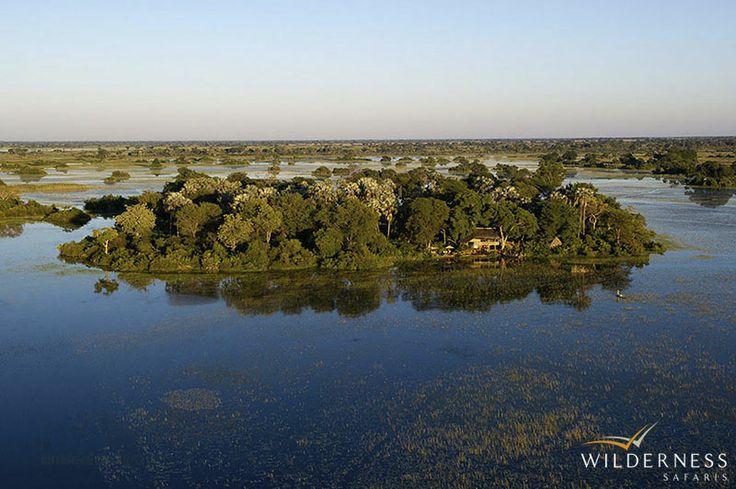 Jacana Camp - Located on a beautiful island and surrounded by seasonally-inundated floodplains and papyrus swamps #Africa #Safari #Botswana