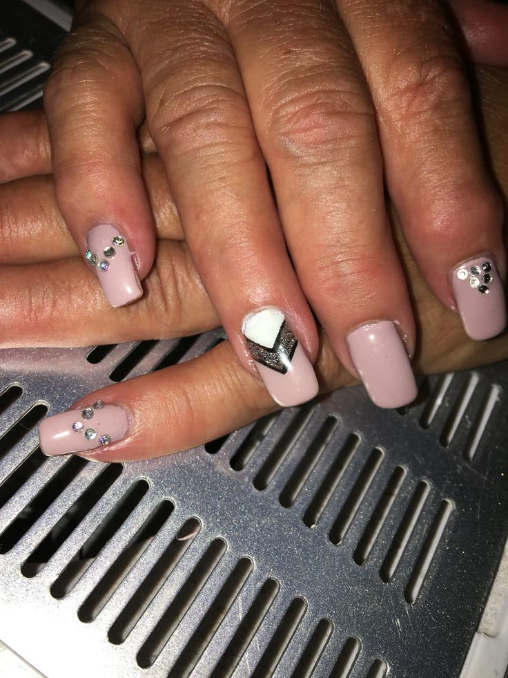 Nude pink with white and gun metal with gems gel nails