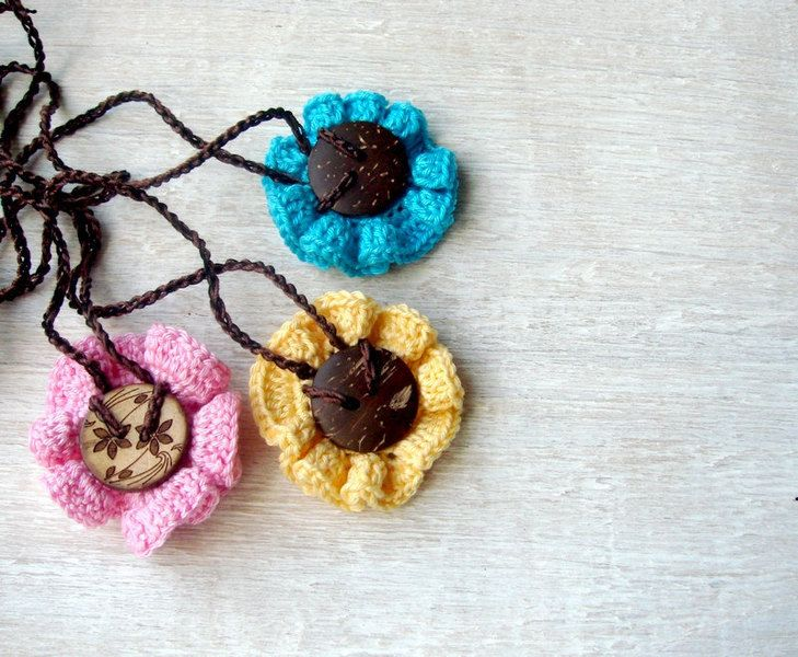 Teething pendant with flower and button from MiracleFromThreads  by DaWanda.com